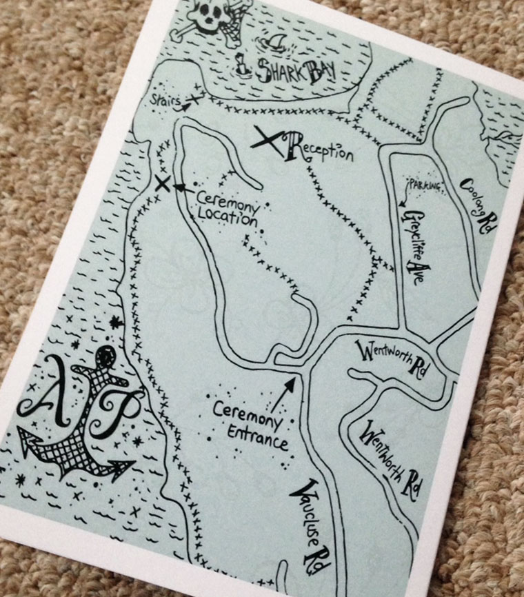 A custom hand drawn map on the back side of a folded wedding invitation