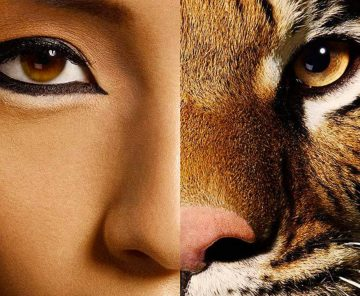 A portrait photo that is have woman and half tiger